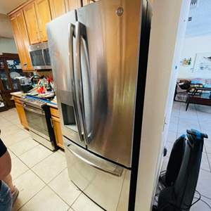 Lot # 35- GE Top French Door stainless steel Refrigerator- less than 1 year old