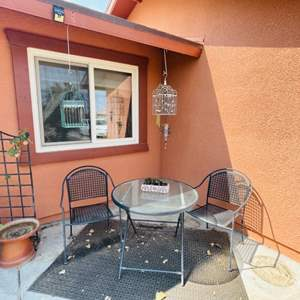 Lot # 103- Patio Table Set, Rug, Bird Cages, and a Plant