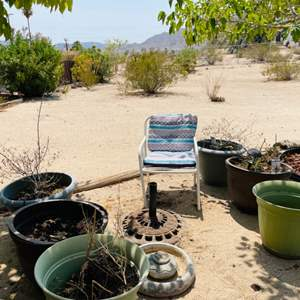 Lot # 124- Plastic Pots, Bird Bath, Chair, and Umbrella Stands