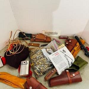 Lot # 171- Holsters, Grips, Pocket Knives & Bass Shells