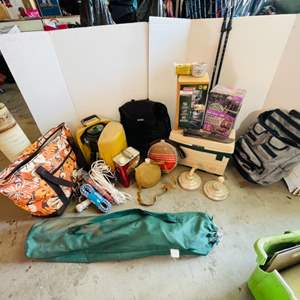 Lot # 176- Outdoor Mega Lot: 2 Coleman Lanterns in box, Pole walking sticks, Rubber box, Canteens, Chair & More